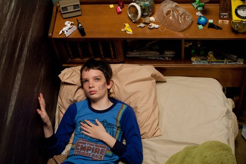Kodi Smit-McPhee in una scena del film Let Me In