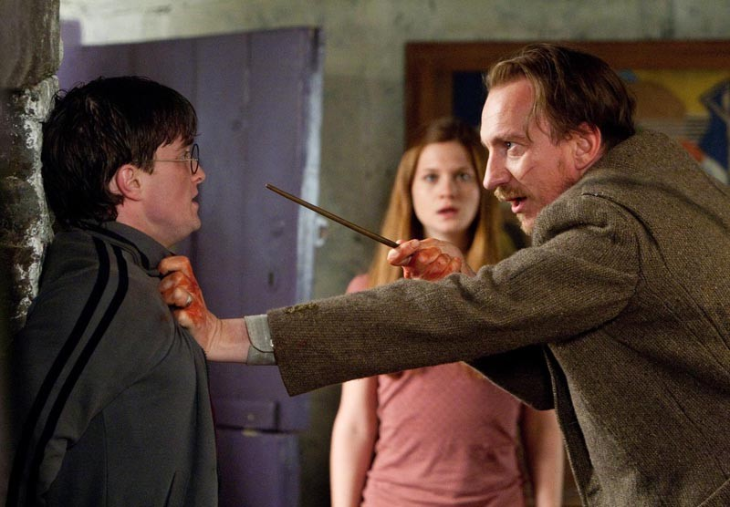 Una scena del film Harry Potter e i Doni della Morte - parte 1 con Daniel Radcliffe, David Thewlis e Bonnie Wright