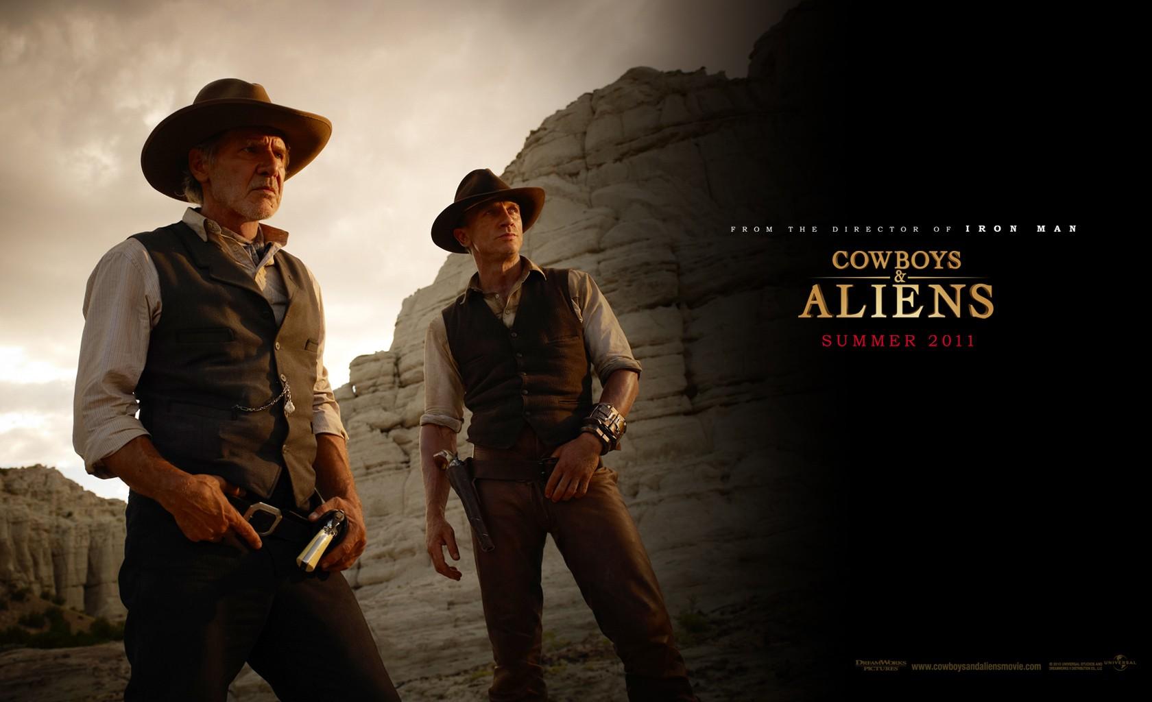 Un wallpaper con i protagonisti principali del film Cowboys & Aliens