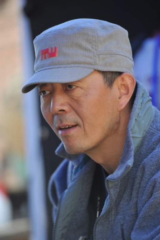 Il regista Gu Changwei sul set del suo film Love for life