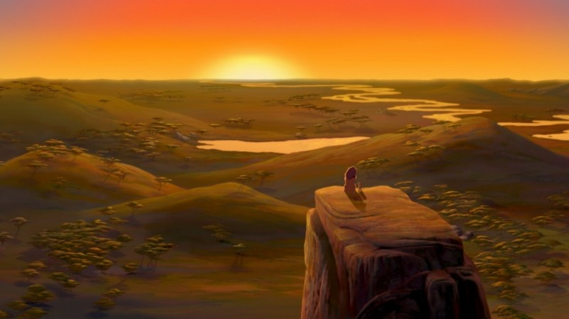 Simba e Mufasa guardano il panorama al tramonto in una scena del film Il re leone 3D