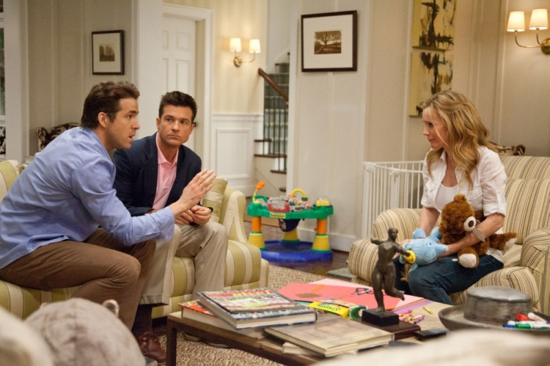 Jason Bateman, Ryan Reynolds e Leslie Mann in una scena di Cambio Vita