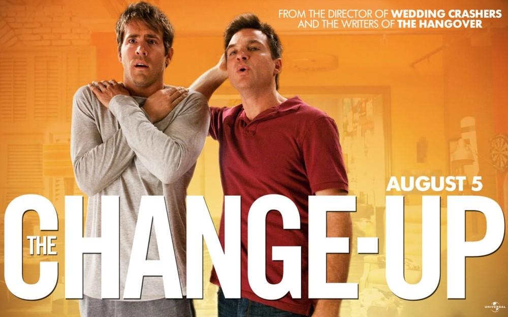 Il wallpaper del film con Ryan Reynolds e Jason Bateman