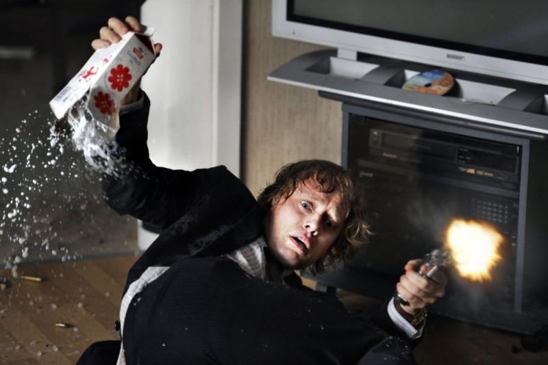 Aksel Hennie in una scena action del film Headhunters