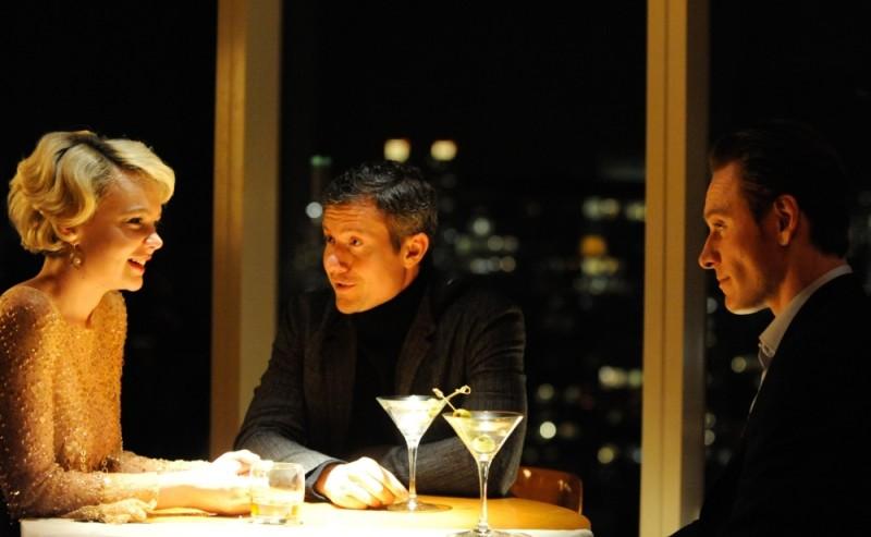 Carey Mulligan, Michael Fassbender e James Badge Dale in una scena del film Shame