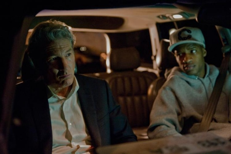 Richard Gere in una scena del thriller Arbitrage insieme a Nate Parker