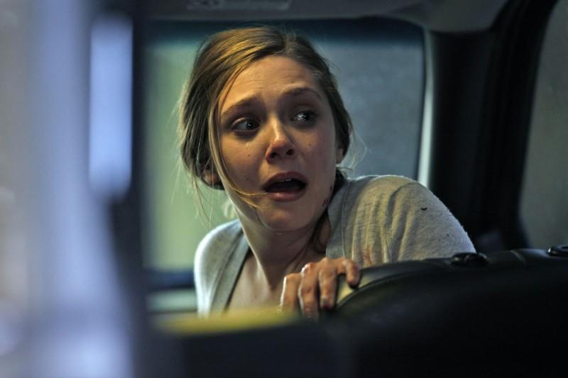 Elizabeth Olsen in una scena di Silent House.