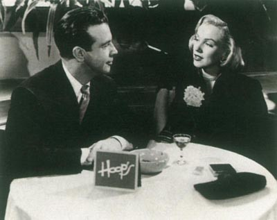 Marilyn Monroe con Dick Powell ne Il messicano