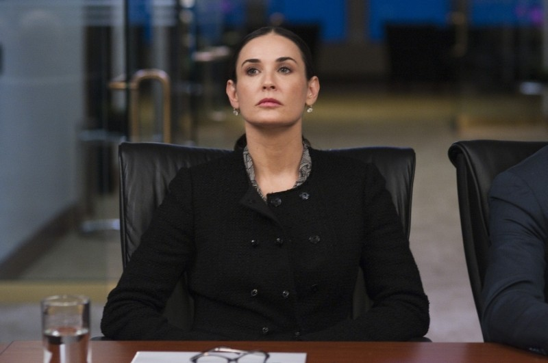 Margin Call: Demi Moore pensierosa in una scena del film