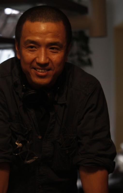 Mystery: il regista Lou Ye sorride sul set del film