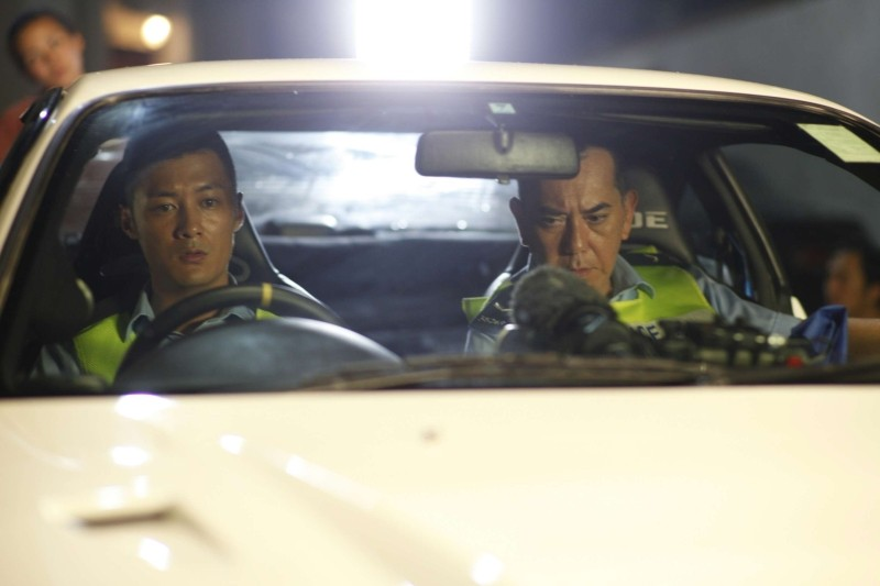 Motorway: Xiaodong Guo con il suo partner Anthony Wong Chau-Sang in una scena del thriller poliziesco