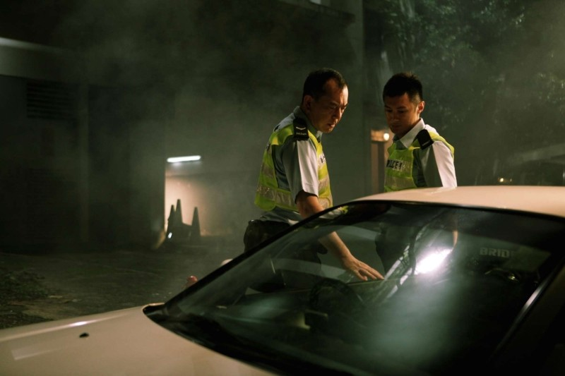 Motorway: Xiaodong Guo e Anthony Wong Chau-Sang in una scena dell'action poliziesco