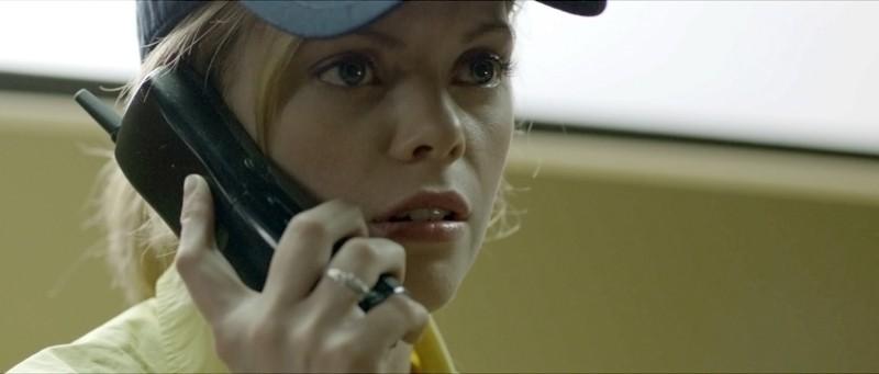 Compliance: la protagonista Dreama Walker in una scena del film nei panni di Becky