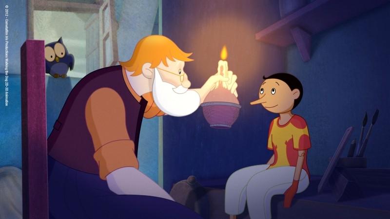 Pinocchio: Mastro Geppetto con il suo Pinocchio in una scena del film di Enzo d'Alò