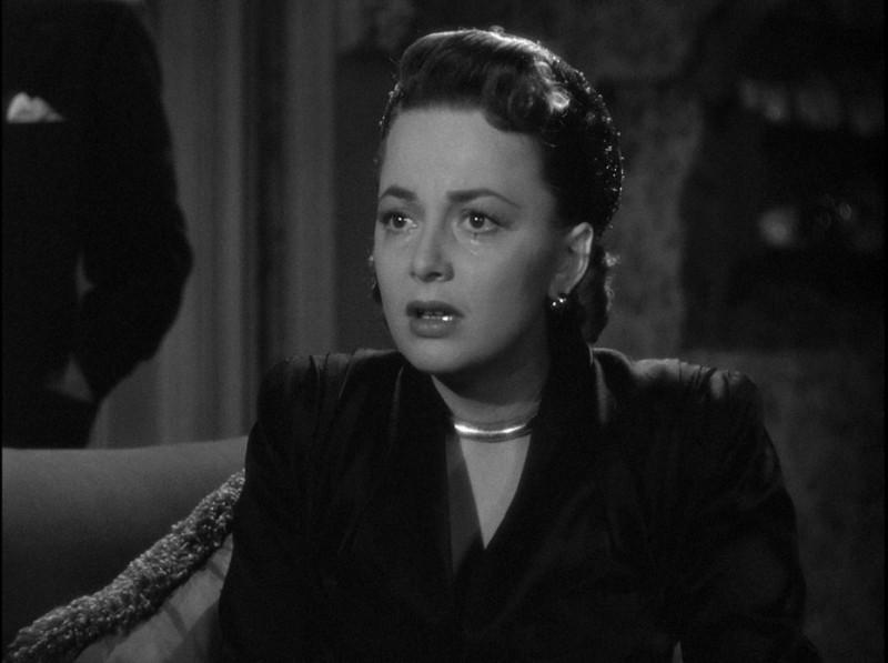Lo specchio scuro: Olivia de Havilland in lacrime nel film