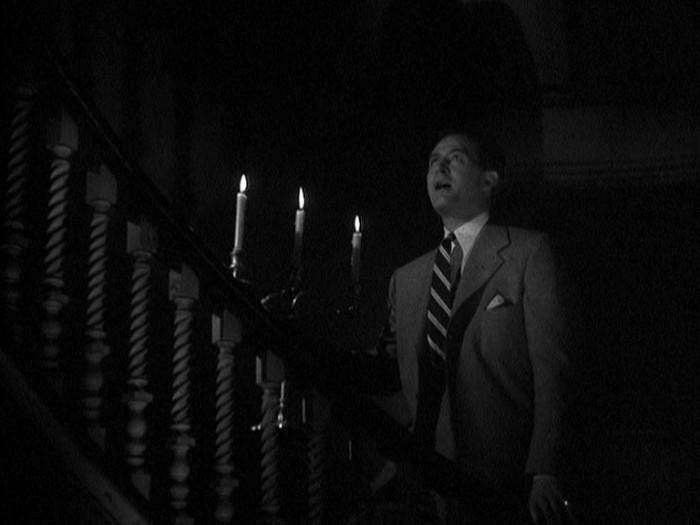 Ray Milland in una scena del film La casa sulla scogliera (1944)