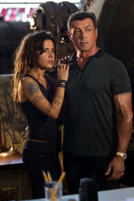 Jimmy Bobo - Bullet to the Head: Sylvester Stallone in una scena del film con Sarah Shahi