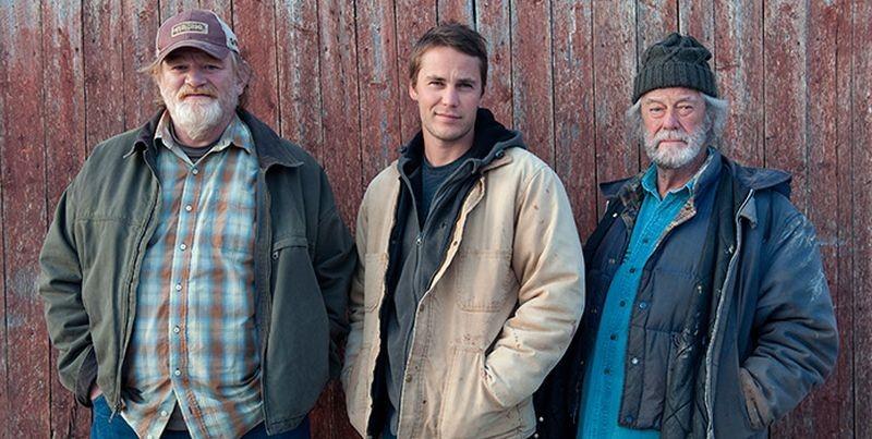 The Grand Seduction: Brendan Gleeson con Taylor Kitsch e Gordon Pinsent in una foto promozionale