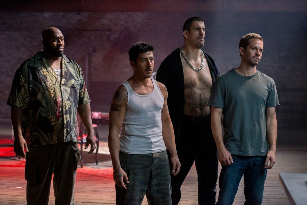Brick Mansions: Paul Walker con David Belle, Robert Maillet e Gouchy Boy in una scena del film