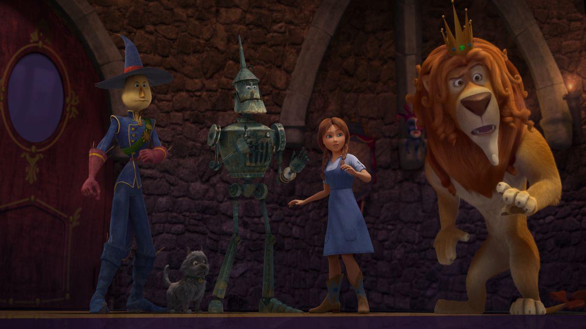 Il magico mondo di Oz: Dorothy con i suoi tre inseparabili compagni di viaggio in una scena