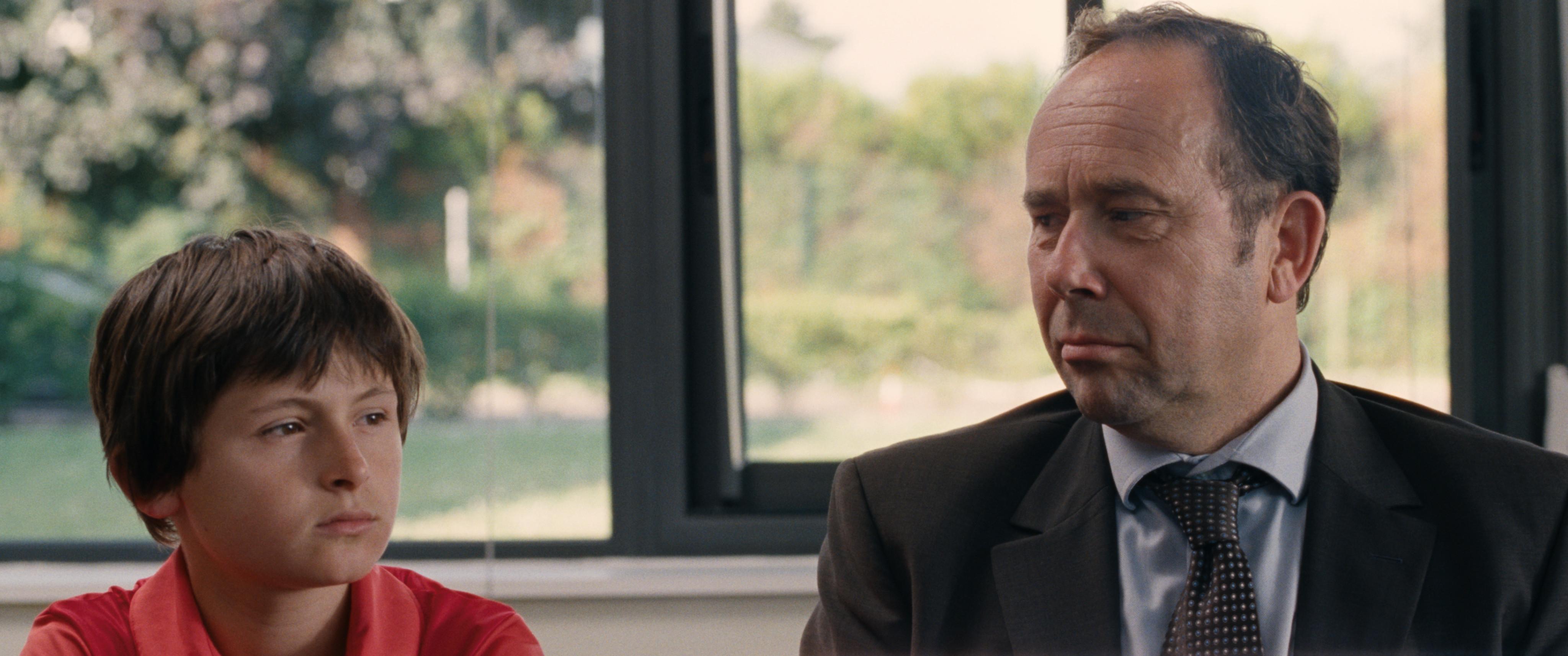 Terre battue: Olivier Gourmet col giovane Charles Mérienne in una scena del film