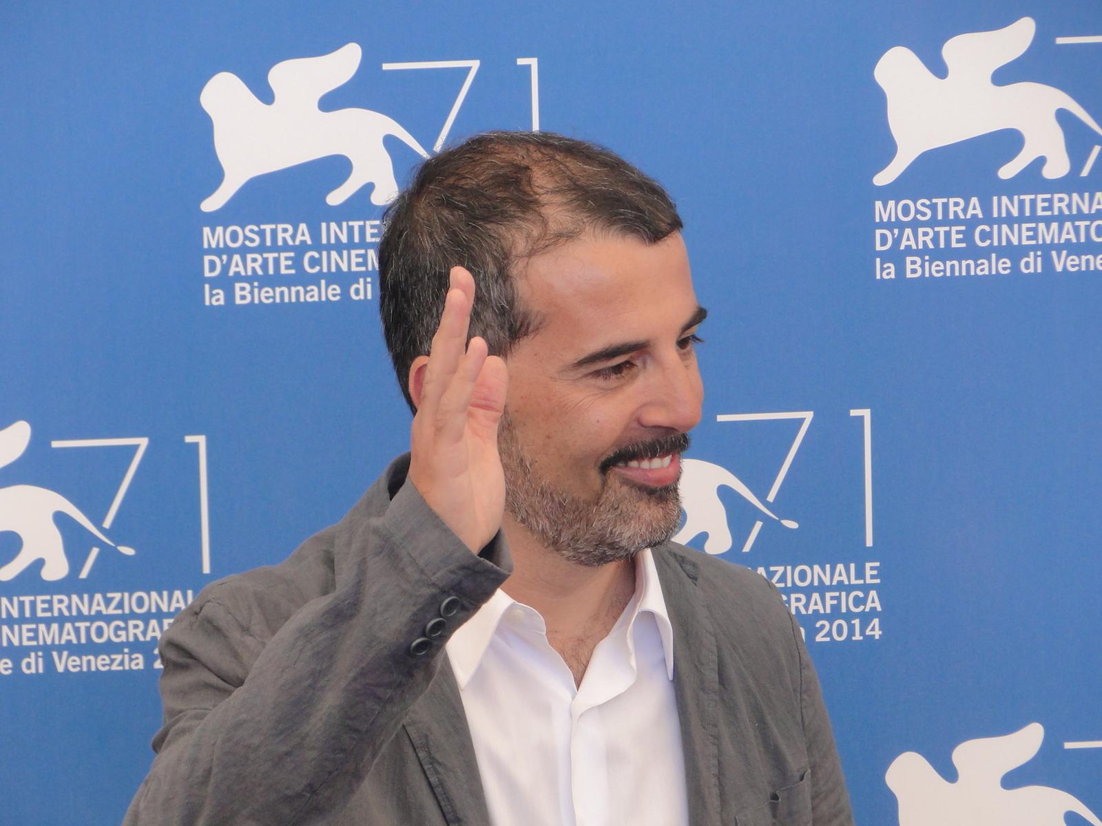 Venezia 2014: Francesco Munzi posa al photocall di Anime nere