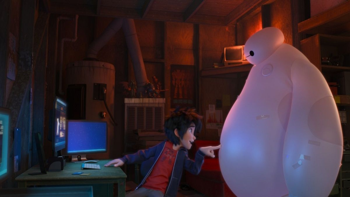 Big Hero 6: Hiro con l'amico robot Baymax in una scena del film d'animazione