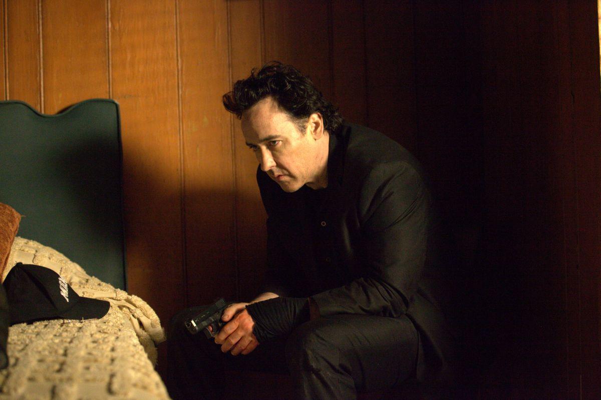 Motel: John Cusack nei panni del killer in una scena del film