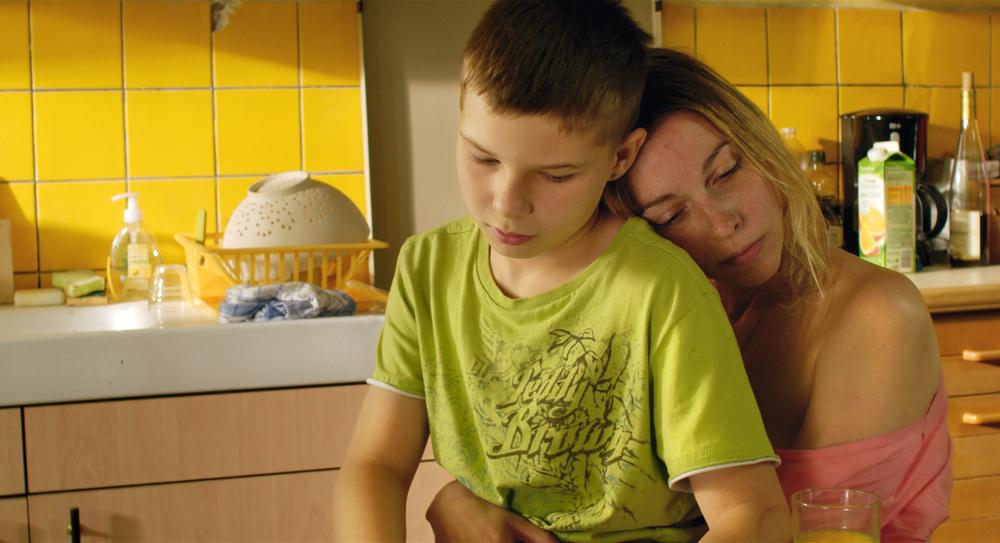 A Childhood: una scena del film con protagonisti Alexi Mathieu e Angelica Sarre