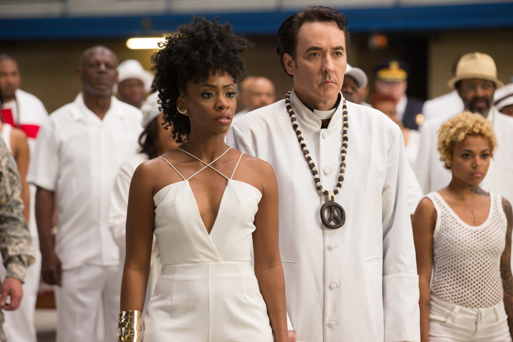 Chi-Raq: Teyonah Parris e John Cusack in un'immagine del film