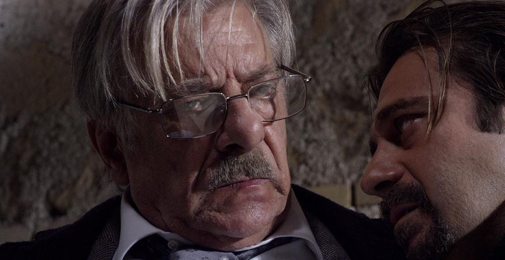Al massimo ribasso: Giancarlo Giannini e Jordi Mollà in una scena del film