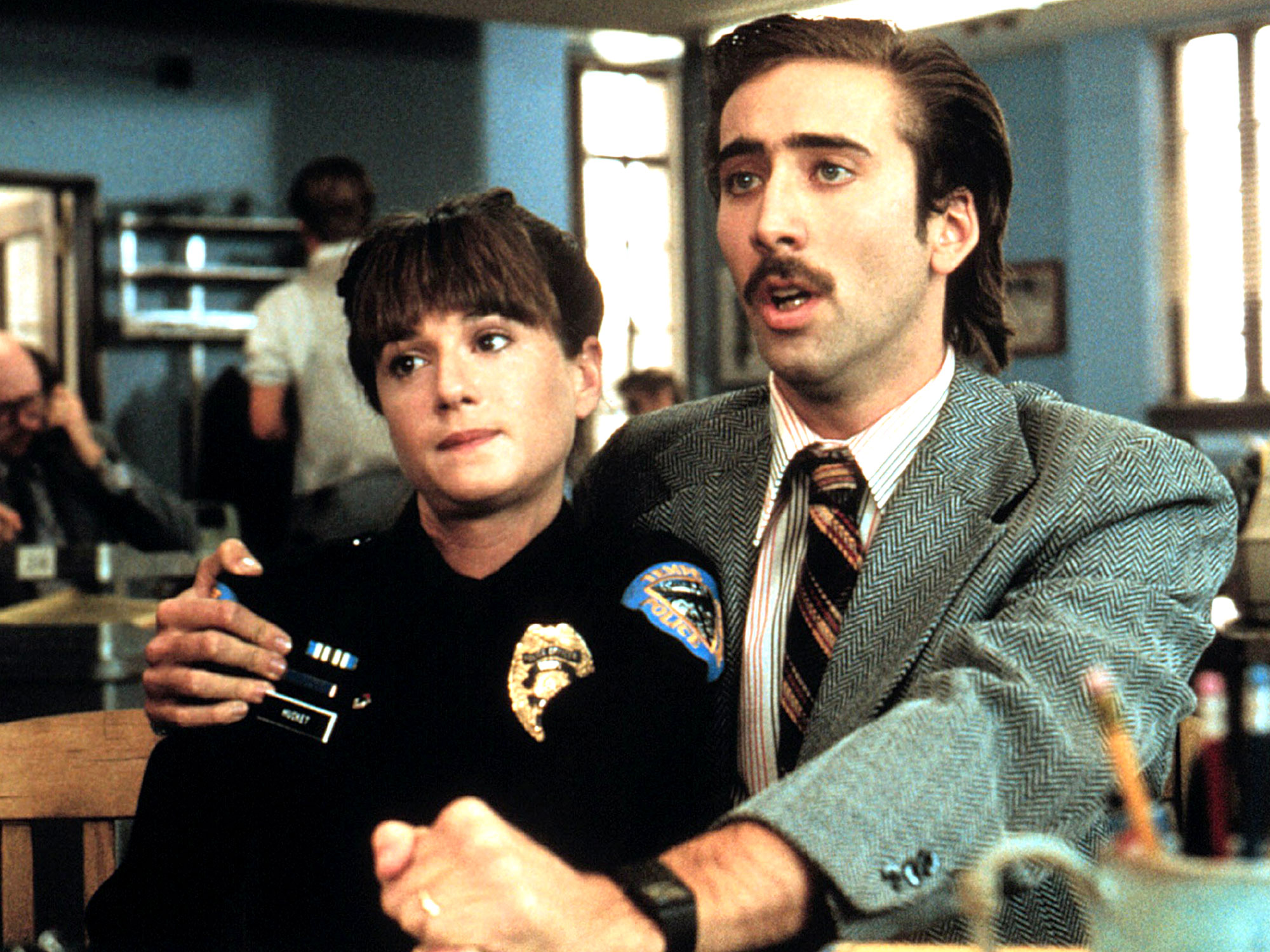 Arizona Junior: Nicolas Cage e Holly Hunter in una scena