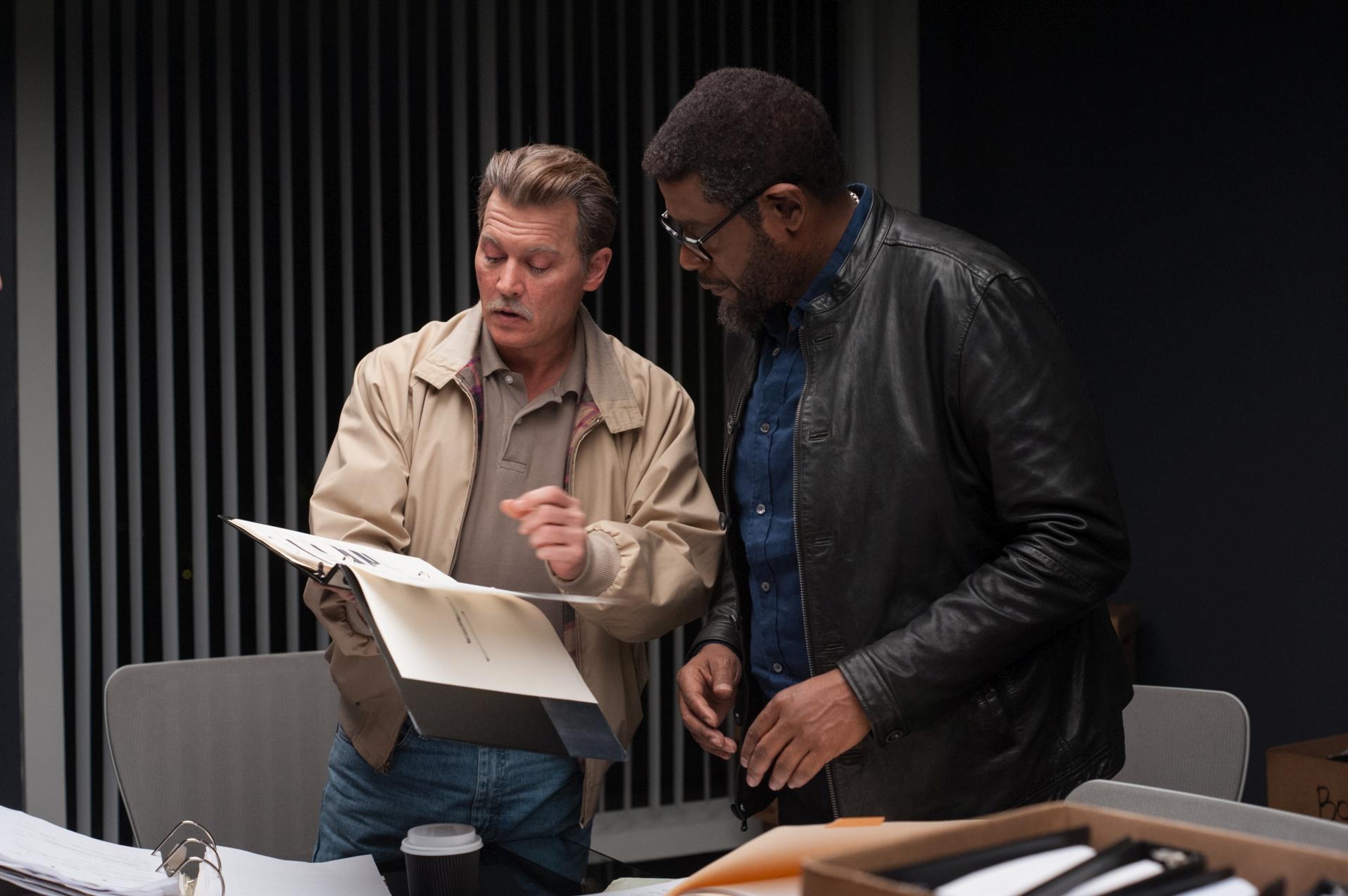City of Lies - L'ora della verità: Johnny Depp in una scena con Forest Whitaker