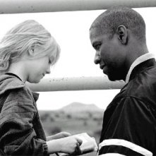 Denzel Washington e Dakota Fanning in una scena del film Man on fire - Il fuoco della vendetta
