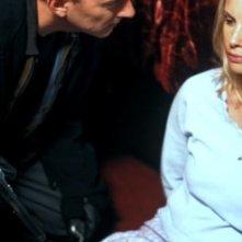 Michael Emerson e Monica Potter in una scena di Saw - L'enigmista