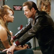 John Travolta e Christina Milian in una scena di Be Cool