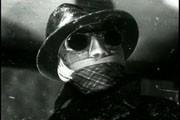 Una foto di Claude Rains nei panni de l'uomo invisibile
