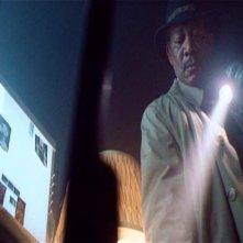 Morgan Freeman in una scena di SEVEN