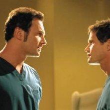 Dylan Walsh e Julian McMahon in un momento della serie Nip/Tuck