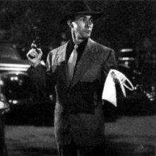 Lauren Bacall, Forbes Murray e Humphrey Bogart in una scena di IL GRANDE SONNO