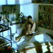 Solveig Dommartin e Sam Neill in una scena del film Fino alla fine del mondo