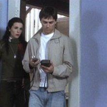 Laura Mennell e Paul Dzenkiw in una scena di 11:11 - La paura ha un nuovo numero