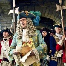 Jonathan Pryce in una scena del film Pirati dei Caraibi: la maledizione del forziere fantasma