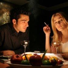 Laura Chiatti e Luca Argentero in una scena del film A casa nostra
