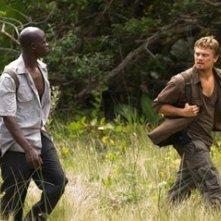 Leonardo DiCaprio e Djimon Hounsou in una scena del film Blood Diamond - Diamanti di sangue