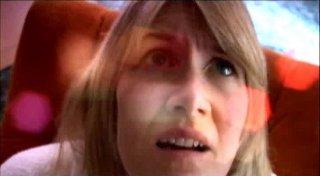 Un primo piano di Laura Dern in una scena di INLAND EMPIRE