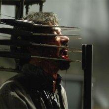 Una scena splatter del film Saw 4