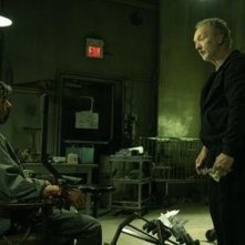 Tobin Bell in una sequenza del thriller Saw 4