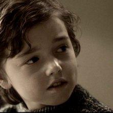 Alex Ferris nei panni del giovane Sam Winchester nell'episodio 'Qualocsa di stregato' in Supernatural