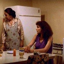 Al Pacino, Miriam Colon e Mary Elizabeth Mastrantonio in una scena di SCARFACE